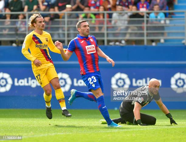 Barcelona's French forward Antoine Griezmann scores against Eibar's Serbian goalkeeper Marko Dmitrovic during the Spanish league football match SD...