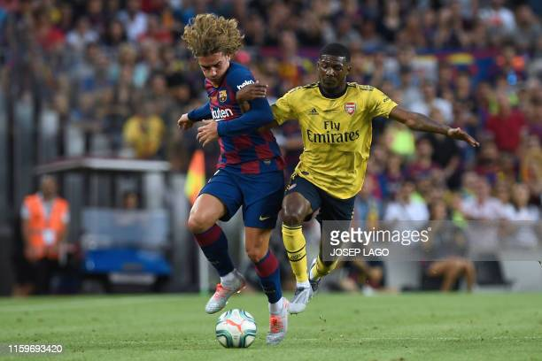 Barcelona's French forward Antoine Griezmann vies with Arsenal's English midfielder Ainsley MaitlandNiles during the 54th Joan Gamper Trophy friendly...