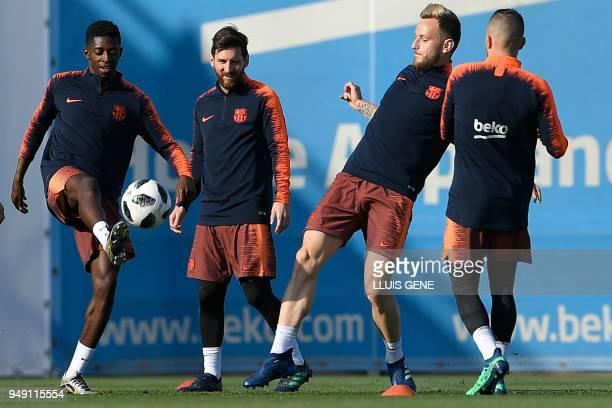 TOPSHOT Barcelona's French forward Ousmane Dembele Barcelona's Argentinian forward Lionel Messi Barcelona's Croatian midfielder Ivan Rakitic and...