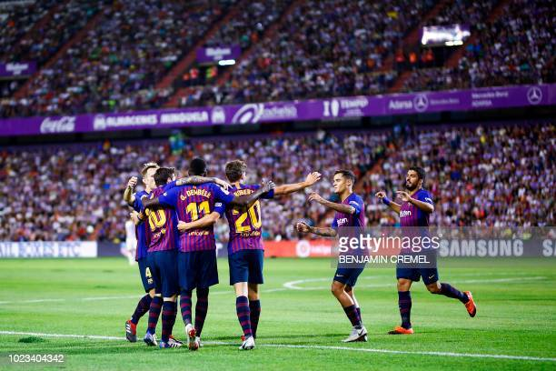 Barcelona's French forward Ousmane Dembele celebrates a goal with teammates during the Spanish league football match between Real Valladolid and FC...