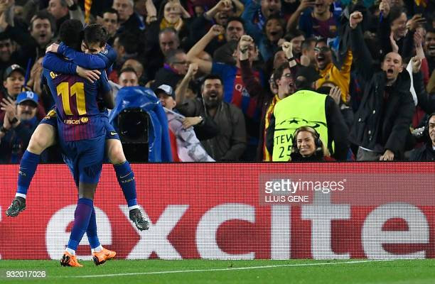 Barcelona's French forward Ousmane Dembele celebrates a goal with Barcelona's Argentinian forward Lionel Messi during the UEFA Champions League round...