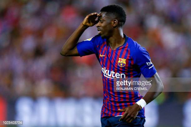 Barcelona's French forward Ousmane Dembele celebrates after scoring a goal during the Spanish league football match between Real Valladolid and FC...