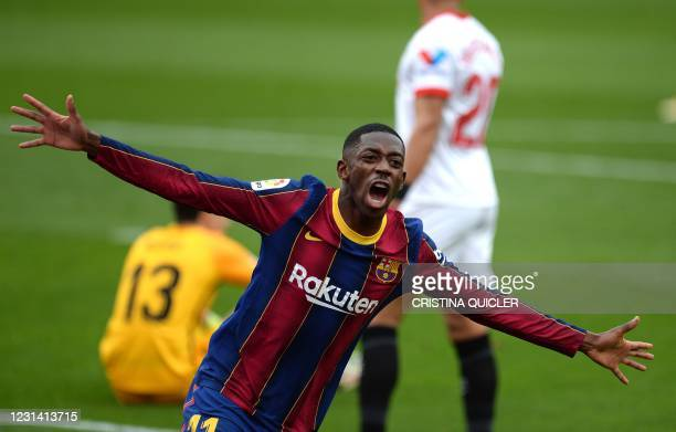 Barcelona's French forward Ousmane Dembele celebrates after scoring a goal during the Spanish league football match between Sevilla FC and FC...