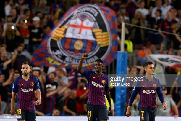 Barcelona's French forward Ousmane Dembele celebrates after scoring during the UEFA Champions' League group B football match FC Barcelona against PSV...