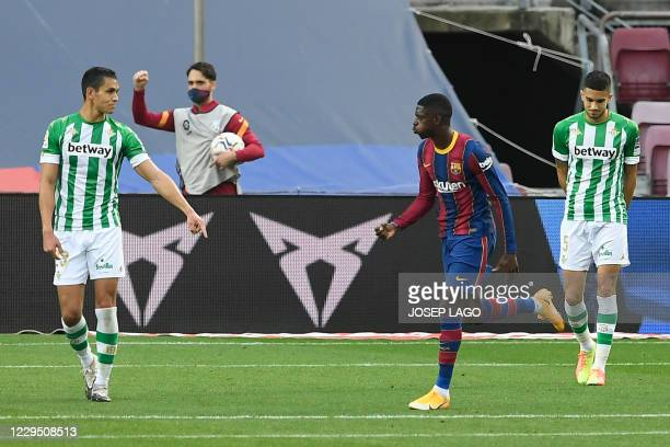 Barcelona's French forward Ousmane Dembele celebrates his goal during the Spanish League football match between Barcelona and Real Betis at the Camp...