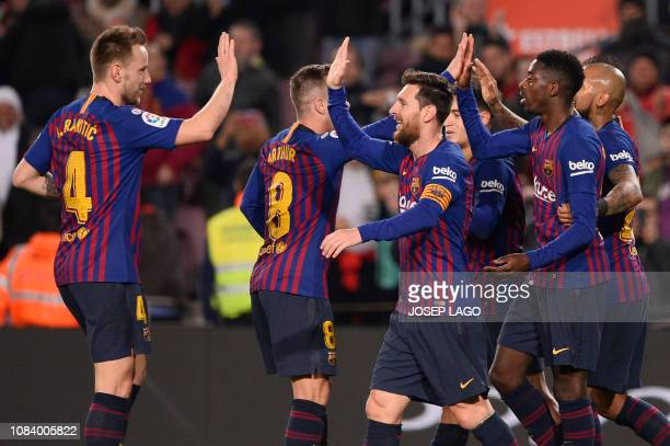 Barcelona's French forward Ousmane Dembele celebrates his second goal with teammates during the Spain's Copa del Rey round of 16 second leg football...