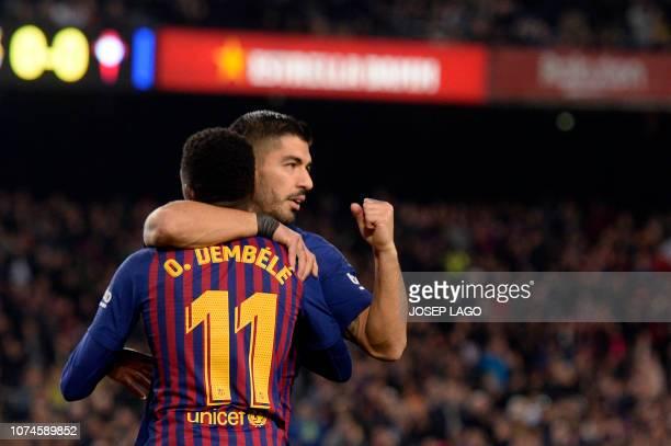 Barcelona's French forward Ousmane Dembele celebrates scoring the opening goal with Barcelona's Uruguayan forward Luis Suarez during the Spanish...