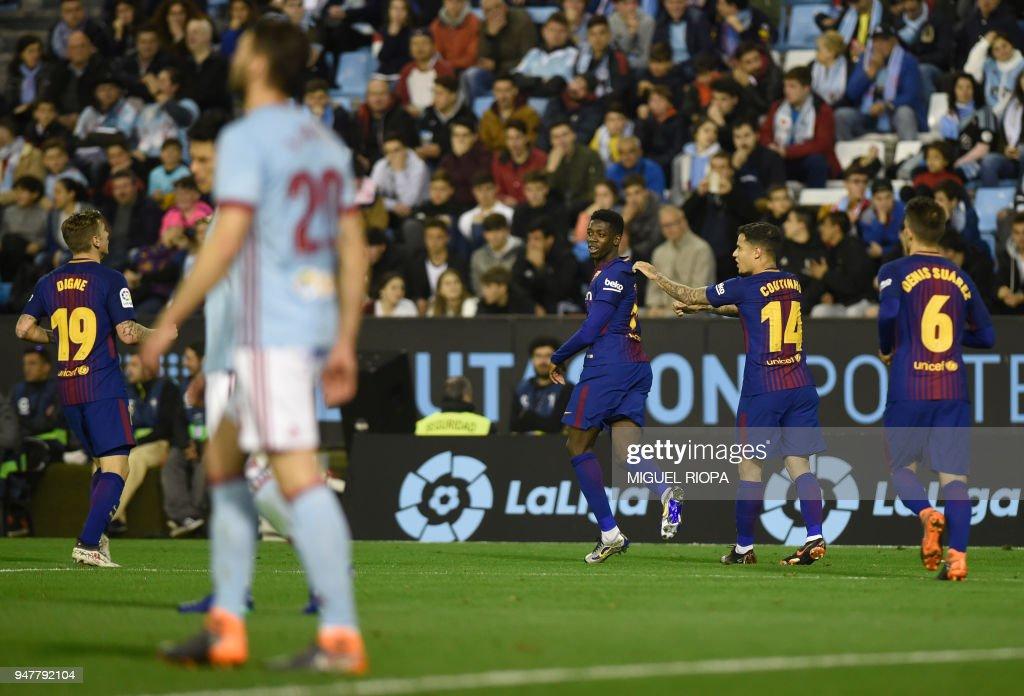 Barcelona's French forward Ousmane Dembele (3R) celebrates the opening goal during the Spanish league football match between RC Celta de Vigo and FC Barcelona at the Balaidos stadium in Vigo on April 17, 2018. /