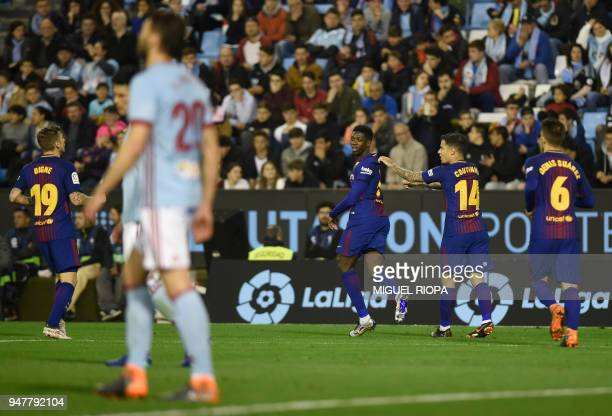 Barcelona's French forward Ousmane Dembele celebrates the opening goal during the Spanish league football match between RC Celta de Vigo and FC...