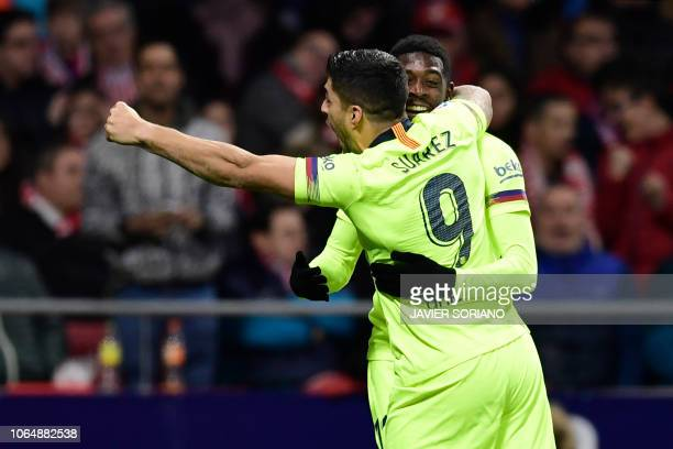 Barcelona's French forward Ousmane Dembele celebrates with Barcelona's Uruguayan forward Luis Suarez after scoring a goal during the Spanish league...