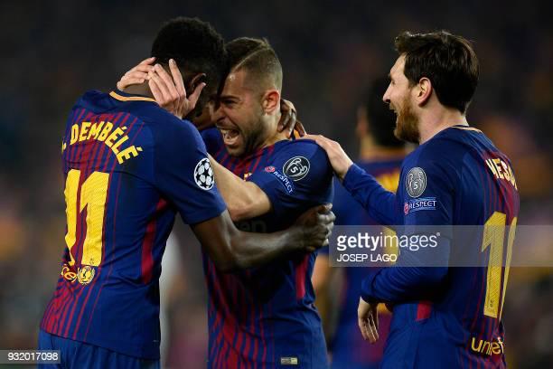 Barcelona's French forward Ousmane Dembele celebrates with Barcelona's Spanish defender Jordi Alba and Barcelona's Argentinian forward Lionel Messi...
