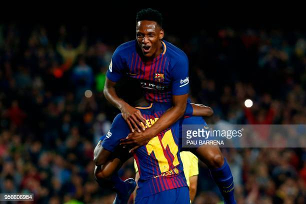 TOPSHOT Barcelona's French forward Ousmane Dembele celebrates with Barcelona's Colombian defender Yerry Mina after scoring a goal during the Spanish...