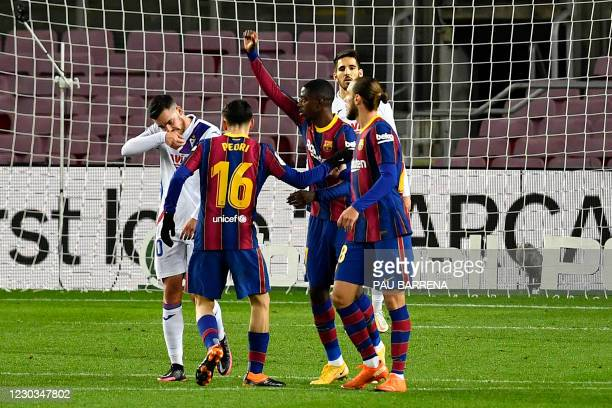 Barcelona's French forward Ousmane Dembele celebrates with teammates after scoring a goal during the Spanish League football match between Barcelona...