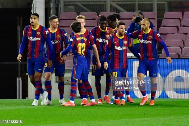 Barcelona's French forward Ousmane Dembele celebrates with teammates after scoring during the Spanish League football match between FC Barcelona and...