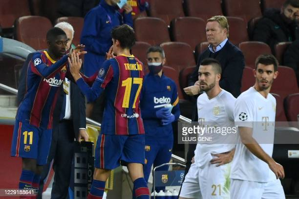 Barcelona's French forward Ousmane Dembele replaces Barcelona's Portuguese forward Francisco Trincao during the UEFA Champions League football match...