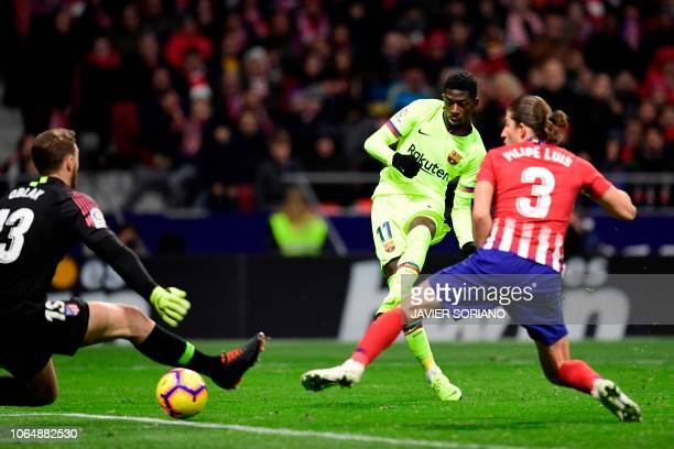 Barcelona's French forward Ousmane Dembele scores a goal during the Spanish league football match between Club Atletico de Madrid and FC Barcelona at...