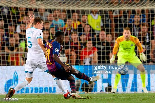 Barcelona's French forward Ousmane Dembele scores during the UEFA Champions' League group B football match FC Barcelona against PSV Eindhoven at the...