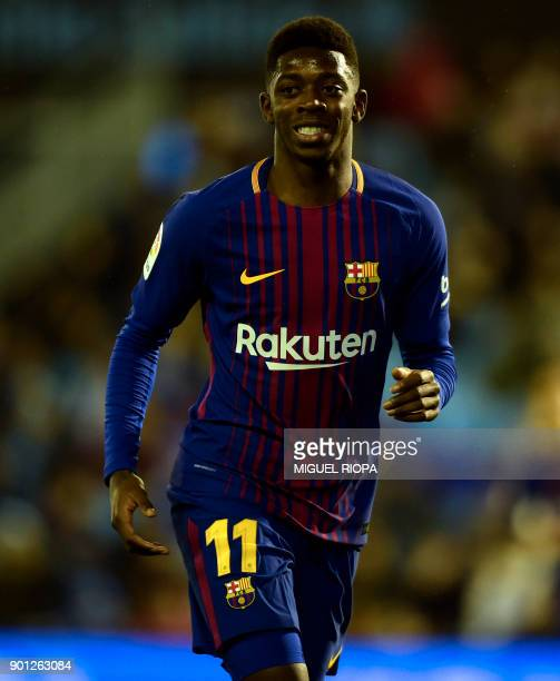 Barcelona's French forward Ousmane Dembele smiles during the Spanish Copa del Rey football match RC Celta de Vigo vs FC Barcelona at the Balaidos...