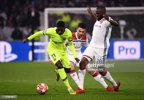 Barcelona's French forward Ousmane Dembele vies for the ball with Lyon's French forward Tanguy Ndombele during the UEFA Champions League round of 16...