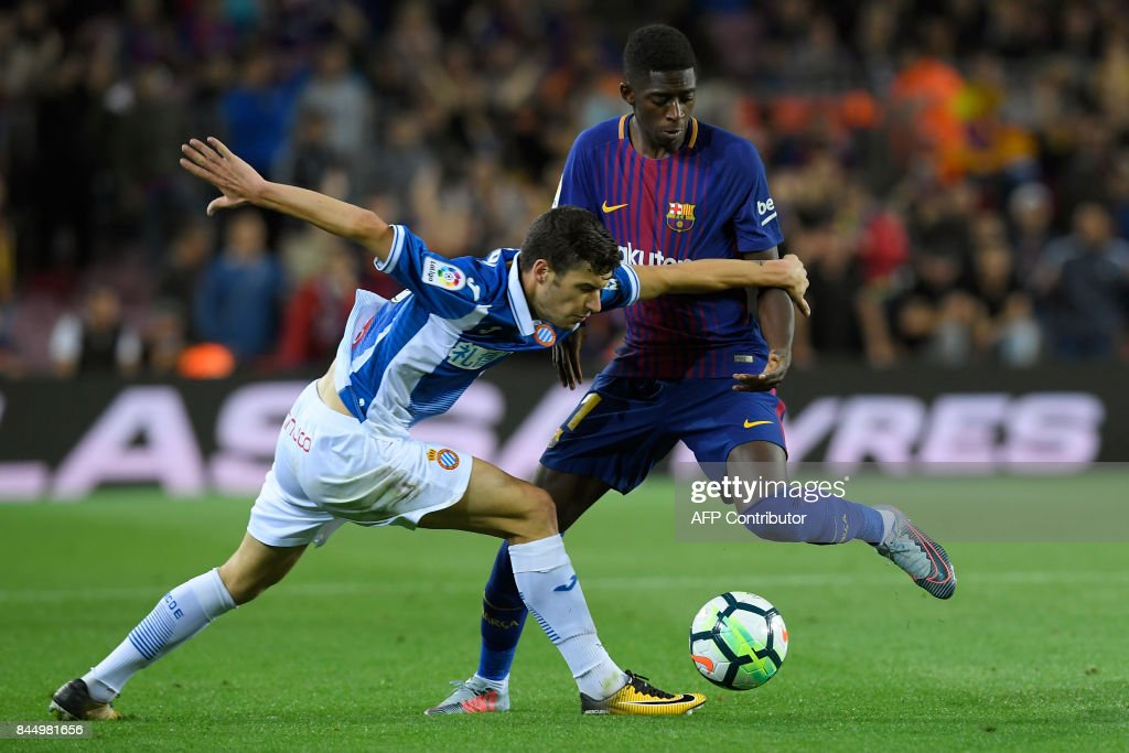 Barcelona's French forward Ousmane Dembele (R) vies for the ball with Espanyol's defender Aron Martin (L) during the Spanish Liga football match Barcelona vs Espanyol at the Camp Nou stadium in Barcelona on September 9, 2017. /