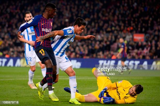 Barcelona's French forward Ousmane Dembele vies with Leganes' Argentinian defender Jonathan Silva and Leganes' Spanish goalkeeper Pichu Cuellar...