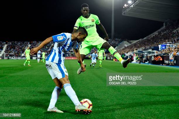 Barcelona's French forward Ousmane Dembele vies with Leganes' Spanish defender Juanfran during the Spanish league football match Club Deportivo...