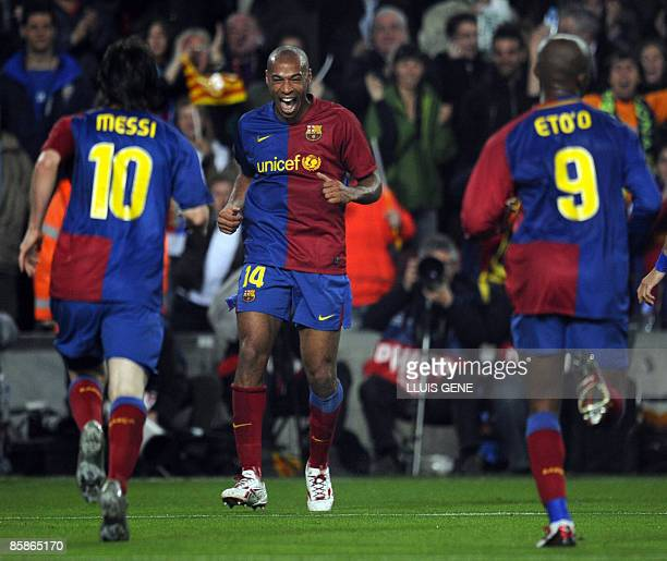 Barcelona´s French forward Thierry Henry celebrates with teammtes Argentinean forward Lionel Messi and Cameroonian forward Samuel Eto´o after scoring...