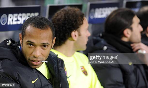 Barcelona's French forward Thierry Henry sits on the substitute bench prior to the VfB Stuttgart vs FC Barcelona UEFA Champions League football round...