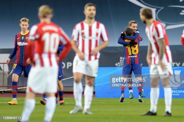 Barcelona's French midfielder Antoine Griezmann celebrates after scoring the opening goal during the Spanish Super Cup final football match between...