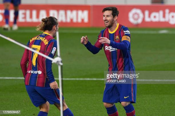 Barcelona's French midfielder Antoine Griezmann celebrates his goal with Barcelona's Argentine forward Lionel Messi during the Spanish League...