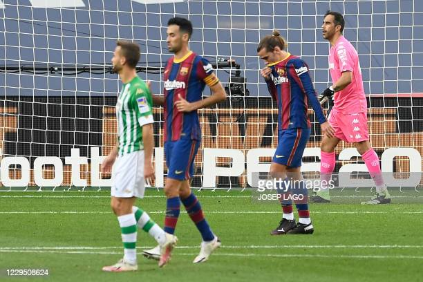 Barcelona's French midfielder Antoine Griezmann reacts after failing to score a penalty kick during the Spanish League football match between...