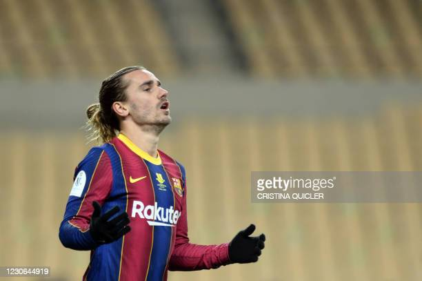 Barcelona's French midfielder Antoine Griezmann reacts to missing a goal opportunity during the Spanish Super Cup final football match between FC...