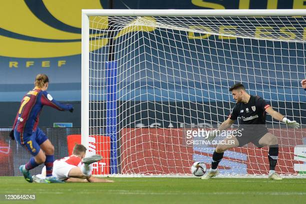 Barcelona's French midfielder Antoine Griezmann scores the opening goal during the Spanish Super Cup final football match between FC Barcelona and...