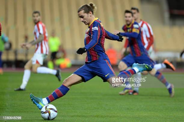 Barcelona's French midfielder Antoine Griezmann shoots during the Spanish Super Cup final football match between FC Barcelona and Athletic Club...