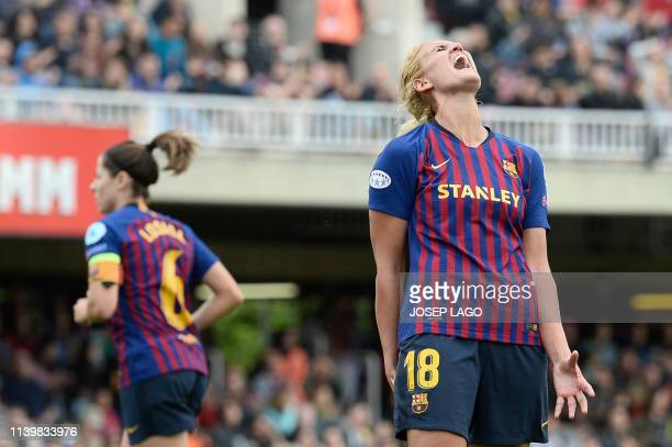 Barcelona's French midfielder Kheira Hamraoui reacts to missing a goal opportunity during the UEFA Women's Champions League semifinal second leg...