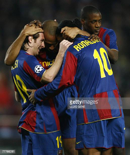 Barcelona's French striker Thierry Henry celebrates with teammates Lionel Messi and Ronaldinho after scoring against Glasgow Rangers during a...