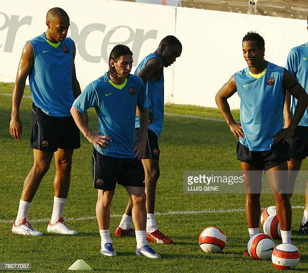 FC Barcelona's French Thierry Henry Argentinan Leo Messi Cameronian Samuel Eto'o and Brazilian Ronaldinho attend during the first training session 13...
