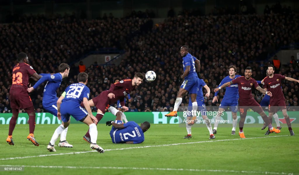 Barcelona's Gerard Pique attempts a headed shot on goal during the UEFA Champions League round of sixteen, first leg match at Stamford Bridge, London.