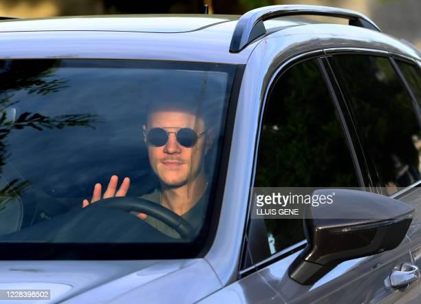 Barcelona's German goalkeeper Marc-Andre Ter Stegen arrives at the Joan Gamper Ciutat Esportiva in Sant Joan Despi near Barcelona for a training...