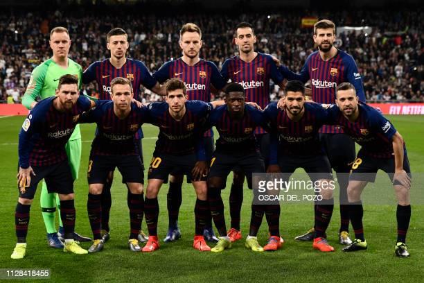 Barcelona's German goalkeeper MarcAndre Ter Stegen Barcelona's French defender Clement Lenglet Barcelona's Croatian midfielder Ivan Rakitic...