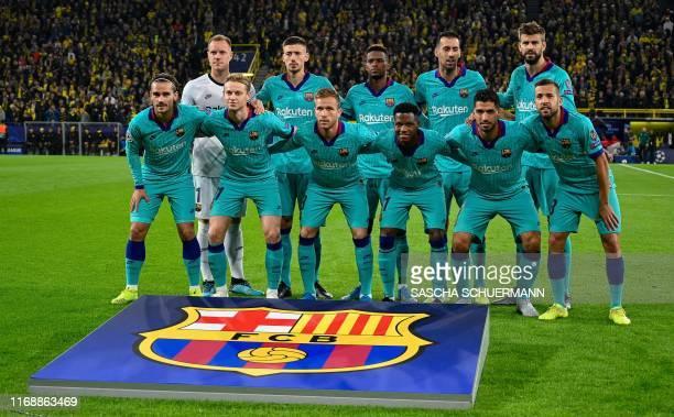 Barcelona's German goalkeeper MarcAndre Ter Stegen Barcelona's French defender Clement Lenglet Barcelona's Portuguese defender Nelson Semedo...