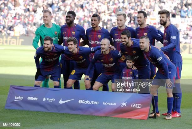 Barcelona's German goalkeeper MarcAndre Ter Stegen Barcelona's French defender Samuel Umtiti Barcelona's Brazilian midfielder Paulinho Barcelona's...