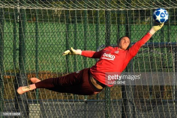 Barcelona's German goalkeeper Marc-Andre Ter Stegen dives for a ball during a training session at the Joan Gamper Sports Center in Sant Joan Despi on...