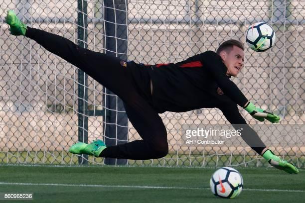 Barcelona's German goalkeeper MarcAndre Ter Stegen dives for a ball during a training session at the Joan Gamper Sports Center in Sant Joan Despi...