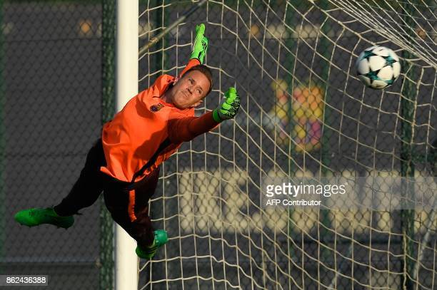 Barcelona's German goalkeeper MarcAndre Ter Stegen dives for the ball during a training session at the Joan Gamper Sports Center in Sant Joan Despi...