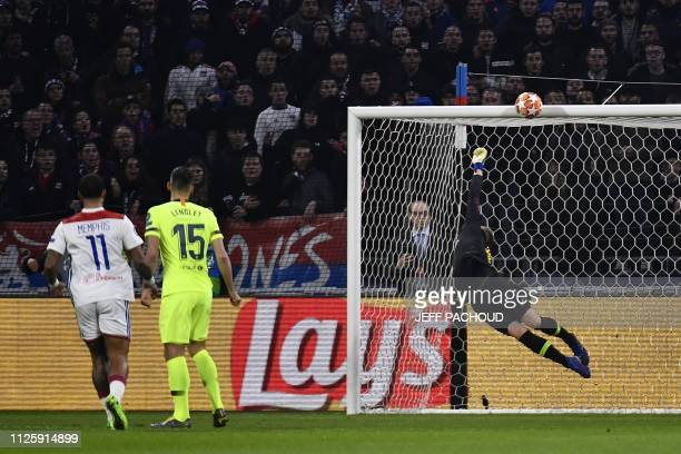 Barcelona's German goalkeeper MarcAndre Ter Stegen dives to save a shoot from Lyon's French forward Martin Terrier during the UEFA Champions League...