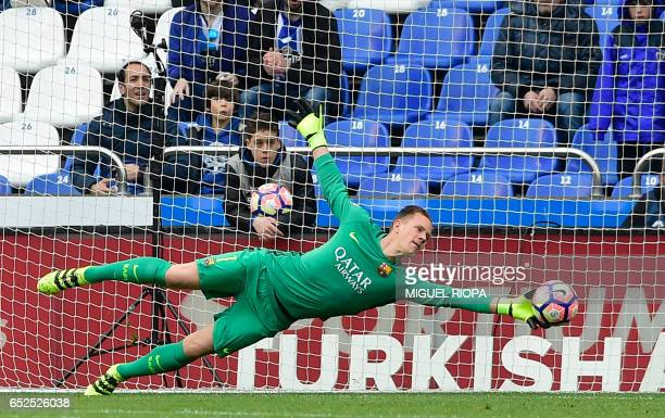 TOPSHOT Barcelona's German goalkeeper MarcAndre Ter Stegen dives to stop a ball during the Spanish league footbal match RC Deportivo de la Coruna vs...