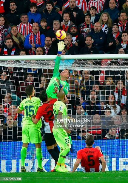 Barcelona's German goalkeeper MarcAndre Ter Stegen jumps for the ball during the Spanish league football match Athletic Club Bilbao against FC...