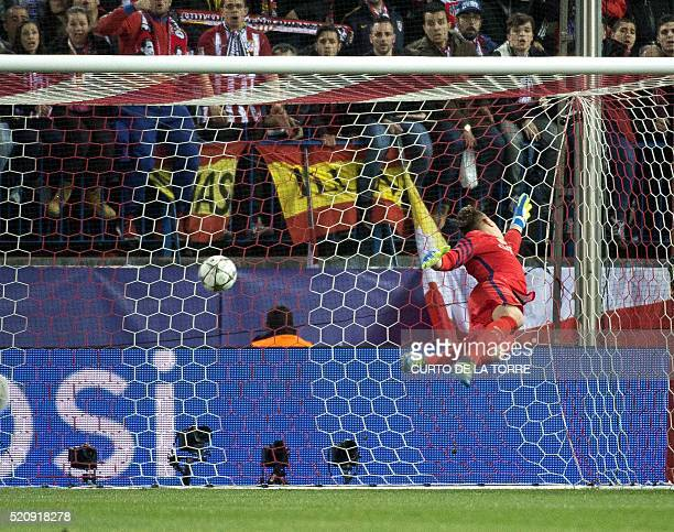 Barcelona's German goalkeeper Marc-Andre Ter Stegen lets through a gola by Atletico Madrid's French forward Antoine Griezmann during the Champions...