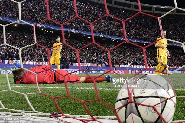 Barcelona's German goalkeeper Marc-Andre Ter Stegen lies on the field after a goal by Atletico Madrid's French forward Antoine Griezmann during the...